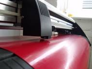 knife cutting red vinyl film